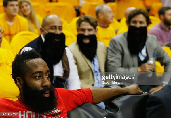 Houston Rockets fans wait behind James Harden of the Houston Rockets near the bench area before the start of their game against the Dallas Mavericks...