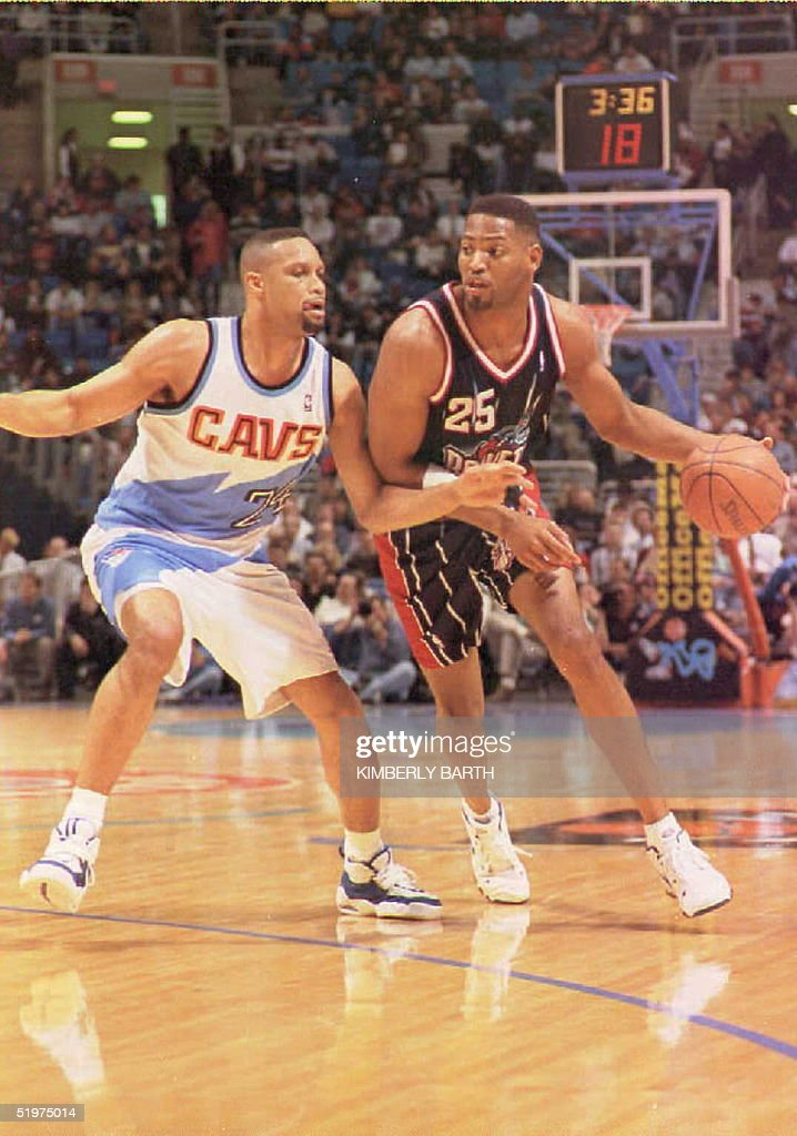 Houston Rockets forward Robert Horry drives for the basket against Chris Mills of the Cleveland Cavaliers in game action at Gund Arena 22 February...