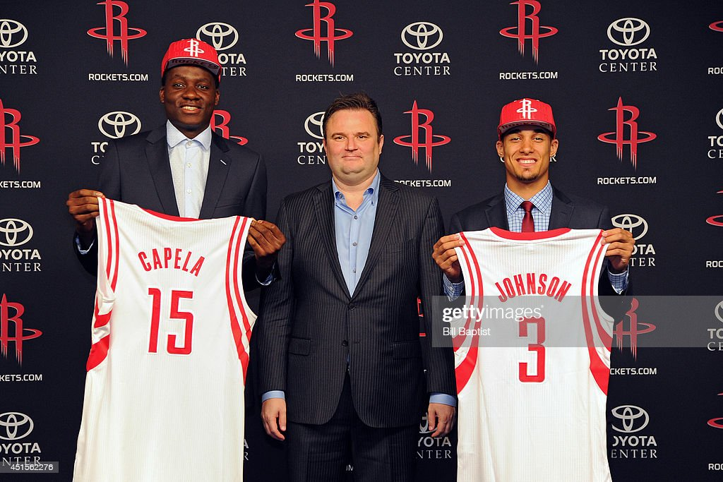 Houston Rockets GM Daryl Morey poses for a photo with the Rockets draft picks Clint Capela #15 and Nick Johnson #3 in Houston, Texas.