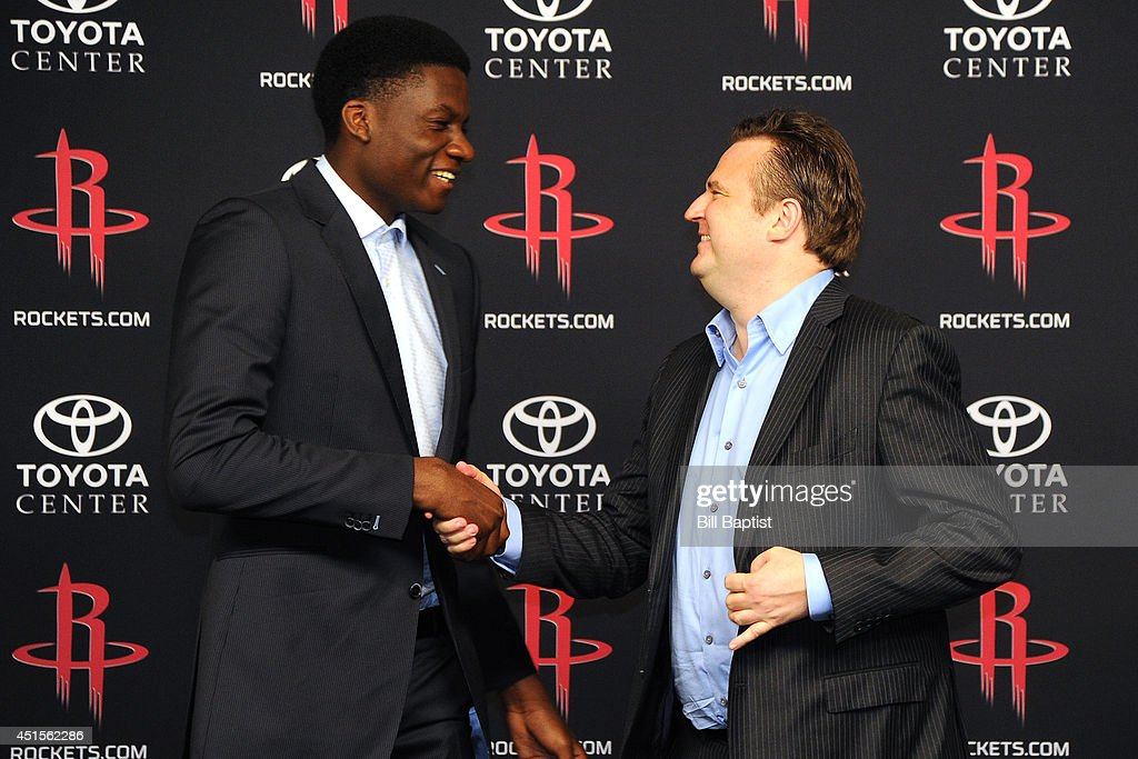 Houston Rockets GM Daryl Morey shakes hands with the Rockets draft pick Clint Capela #15 during a press conference in Houston, Texas.