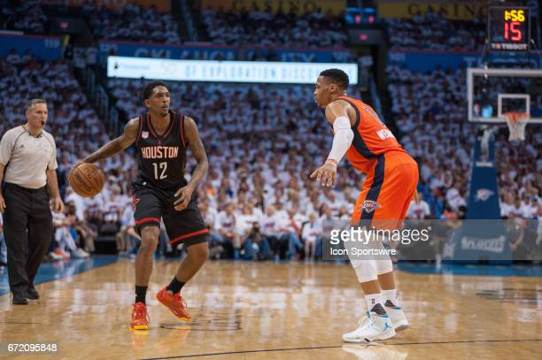 Houston Rockets Guard Lou Williams looks for a pass while Oklahoma City Thunder Guard Russell Westbrook plays defense during the game 4 of the first...