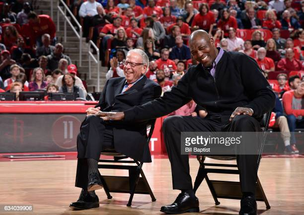 Houston Rockets owner Leslie Alexander and Hakeem Olajuwon share a laugh during Yao Ming's jersey retirement ceremony at halftime of the game between...