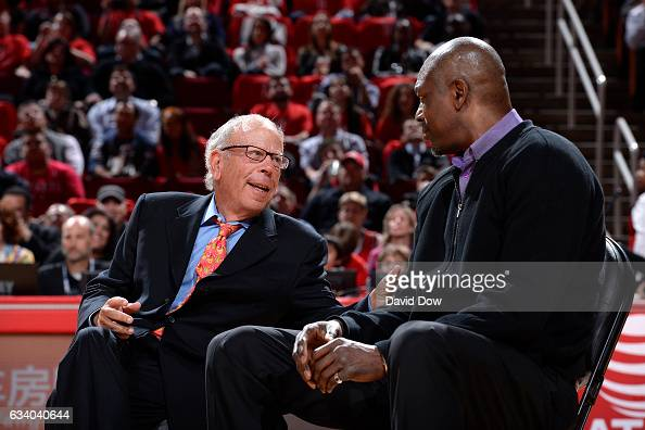 Houston Rockets owner Leslie Alexander and NBA Legend Hakeem Olajuwon talk during the Yao Ming jersey retirement ceremony during the Chicago Bulls...