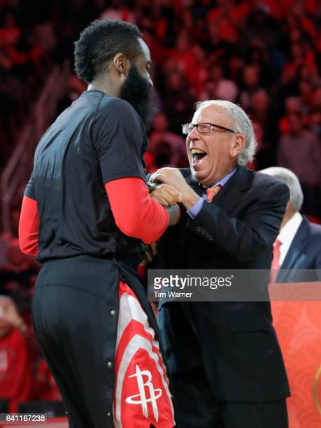 Houston Rockets owner Leslie Alexander celebrates with James Harden of the Houston Rockets after the jersey retirement of Yao Ming during halftime...