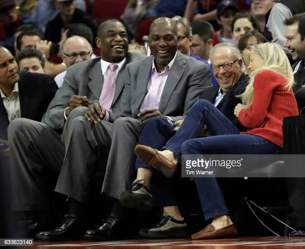 Houston Rockets Owner Leslie Alexander laughs with Hakeem Olajuwan and Dikembe Mutombo after Trevor Ariza of the Houston Rockets landed on the...