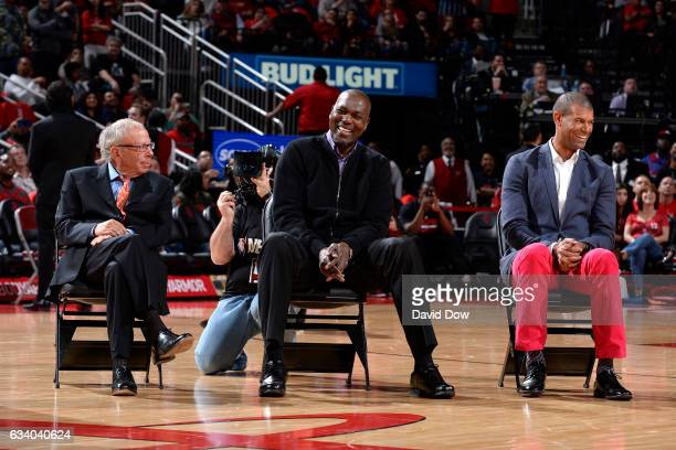 Houston Rockets owner Leslie Alexander with NBA Legends Hakeem Olajuwon and Shane Battier look on during the Yao Ming jersey retirement ceremony...