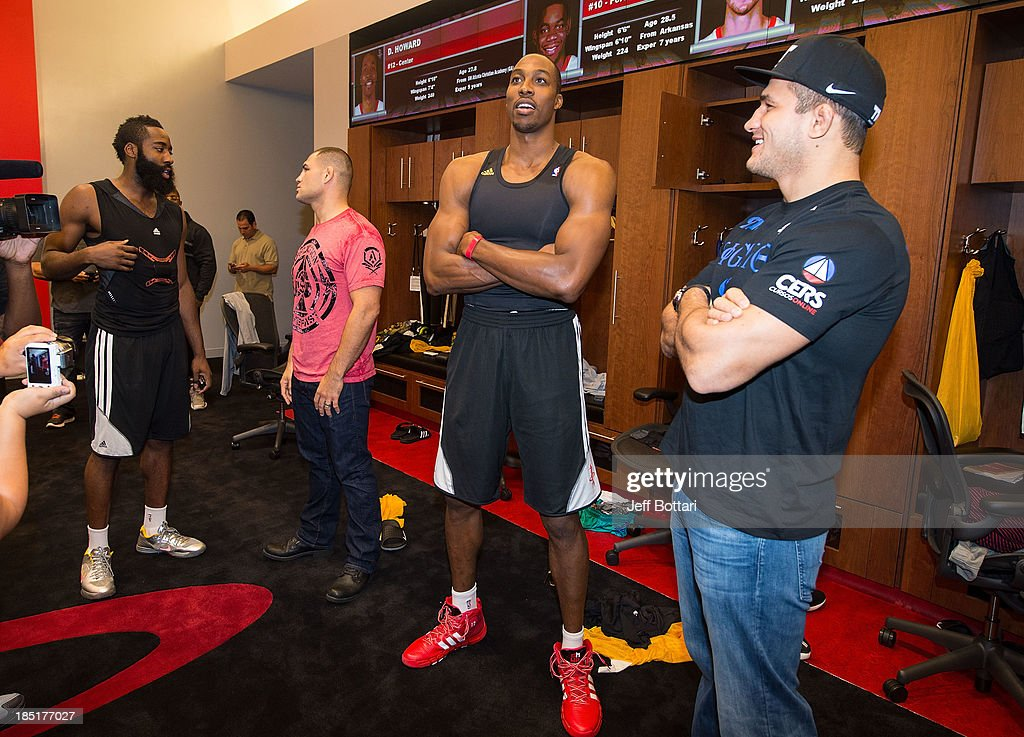 NBA Houston Rockets player <a gi-track='captionPersonalityLinkClicked' href=/galleries/search?phrase=James+Harden&family=editorial&specificpeople=4215938 ng-click='$event.stopPropagation()'>James Harden</a>, UFC heavyweight champion <a gi-track='captionPersonalityLinkClicked' href=/galleries/search?phrase=Cain+Velasquez&family=editorial&specificpeople=5445619 ng-click='$event.stopPropagation()'>Cain Velasquez</a>, NBA Houston Rockets player <a gi-track='captionPersonalityLinkClicked' href=/galleries/search?phrase=Dwight+Howard&family=editorial&specificpeople=201570 ng-click='$event.stopPropagation()'>Dwight Howard</a> and UFC fighter Junior Dos Santos interact in the Houston Rockets locker room during the UFC 166 Ultimate Media Day at the Toyota Center on October 16, 2013 in Houston, Texas.