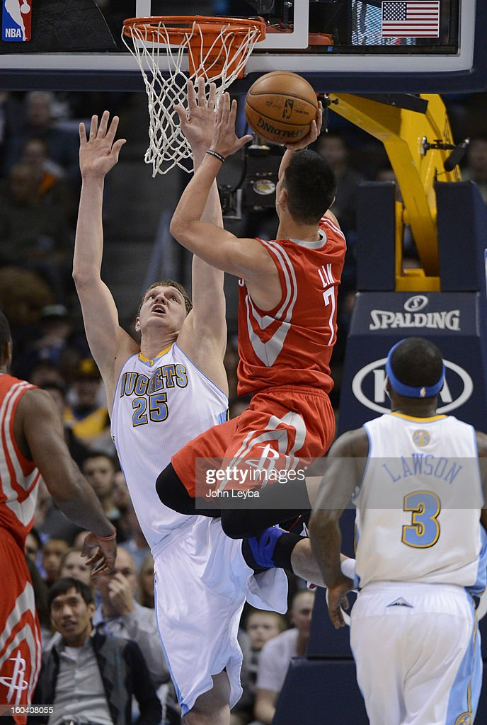 Houston Rockets point guard Jeremy Lin (7) gets fouled by Denver Nuggets center Timofey Mozgov (25) as he drives to the basket during the first quarter January 30, 2013 at Pepsi Center. The Denver Nuggets take on the Houston Rockets in NBA action.