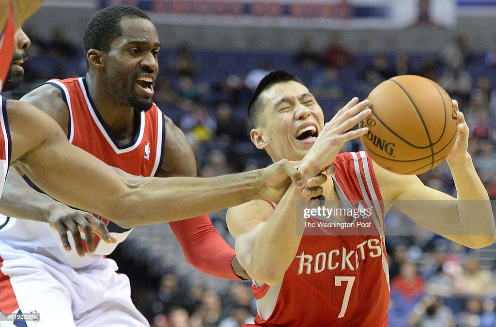 Houston Rockets point guard Jeremy Lin (7) reacts as Washington Wizards power forward Nene (42) fouls him during second half action on January, 11 2014 in Washington, DC.