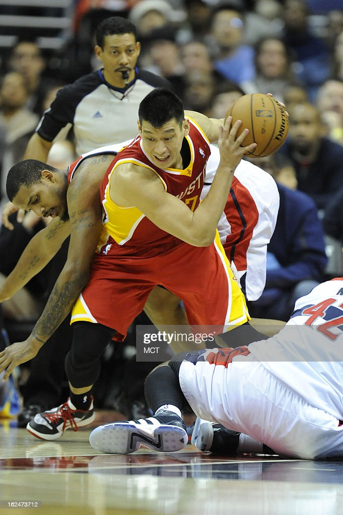 Houston Rockets point guard Jeremy Lin (7) steals the ball from Washington Wizards small forward Trevor Ariza (1) during second-half action at the Verizon Center in Washington, D.C., Saturday, February 23, 2013. The Wizards defeated the Rockets, 105-103.