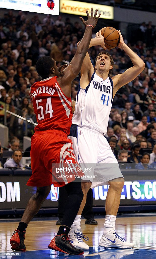 Houston Rockets power forward Patrick Patterson (54) guards Dallas Mavericks power forward Dirk Nowitzki (41) during the first half at the American Airlines Center on Wednesday, January 16, 2013, in Dallas, Texas.