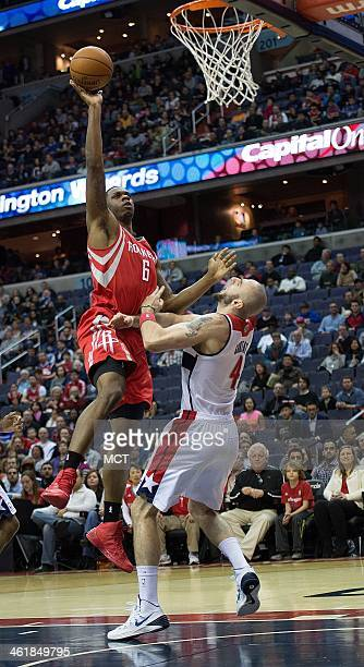Houston Rockets power forward Terrence Jones charges into Washington Wizards center Marcin Gortat for a foul during the first half of their game...