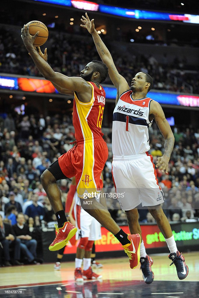 Houston Rockets shooting guard James Harden (13) drives to basket by Washington Wizards small forward Trevor Ariza (1) during second-half action at the Verizon Center in Washington, D.C., Saturday, February 23, 2013. The Wizards defeated the Rockets, 105-103.