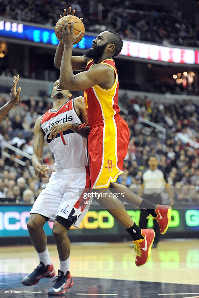 Houston Rockets shooting guard James Harden (13) drives to the basket over Washington Wizards small forward Trevor Ariza (1) during second-half action at the Verizon Center in Washington, D.C., Saturday, February 23, 2013. The Wizards defeated the Rockets, 105-103.