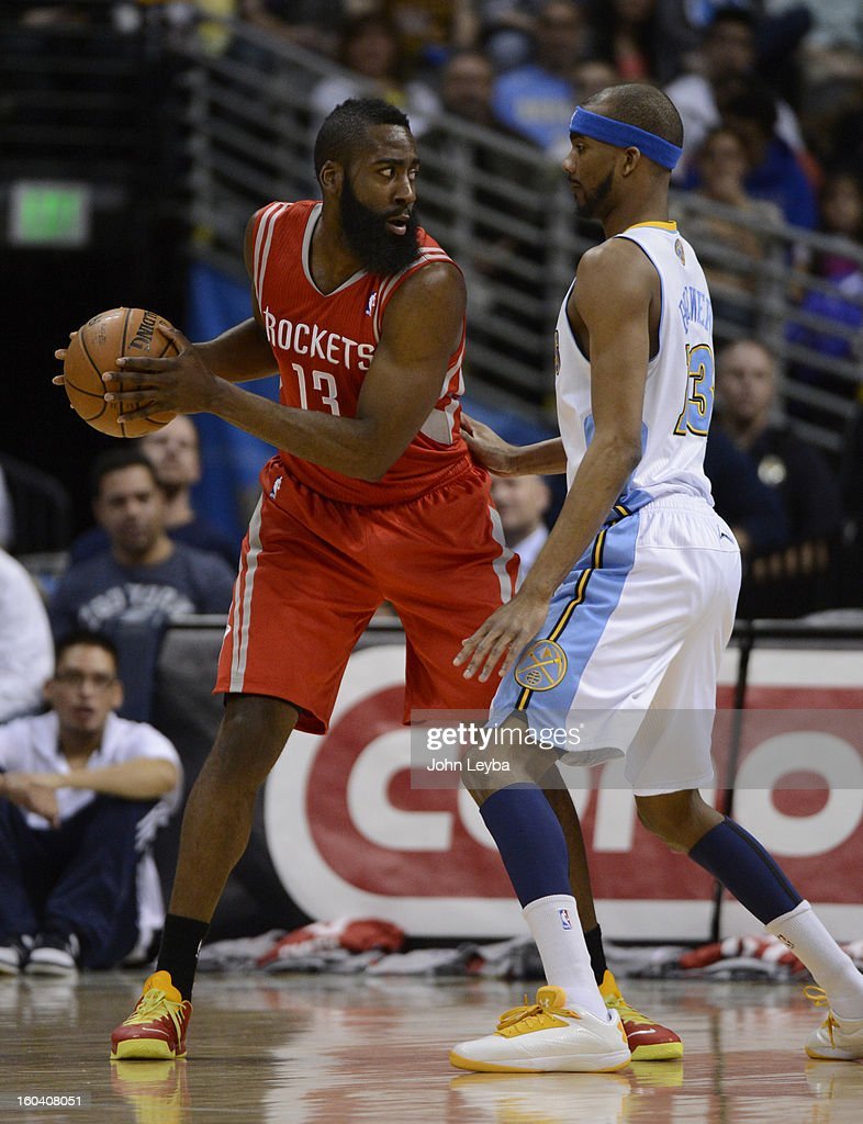 Houston Rockets shooting guard James Harden (13) is guarded by Denver Nuggets small forward Corey Brewer (13) during the first quarter January 30, 2013 at Pepsi Center. The Denver Nuggets take on the Houston Rockets in NBA action.