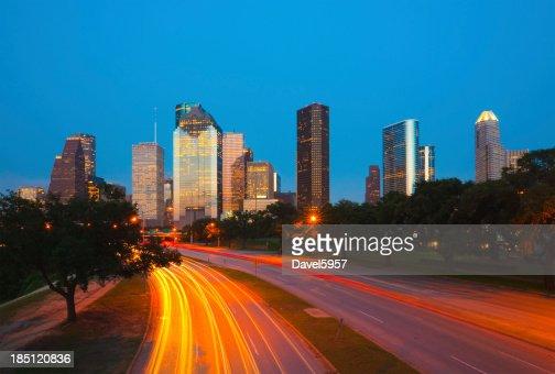 Houston skyline and light trails at dusk
