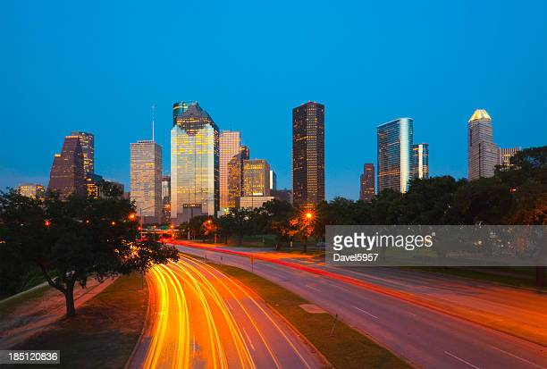 Houston skyline and light trails at dusk