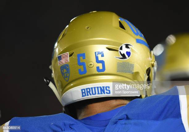 Houston Strong sticker is displayed on the back of the UCLA helmets in support of the victims of Hurricane Harvey during a college football game...