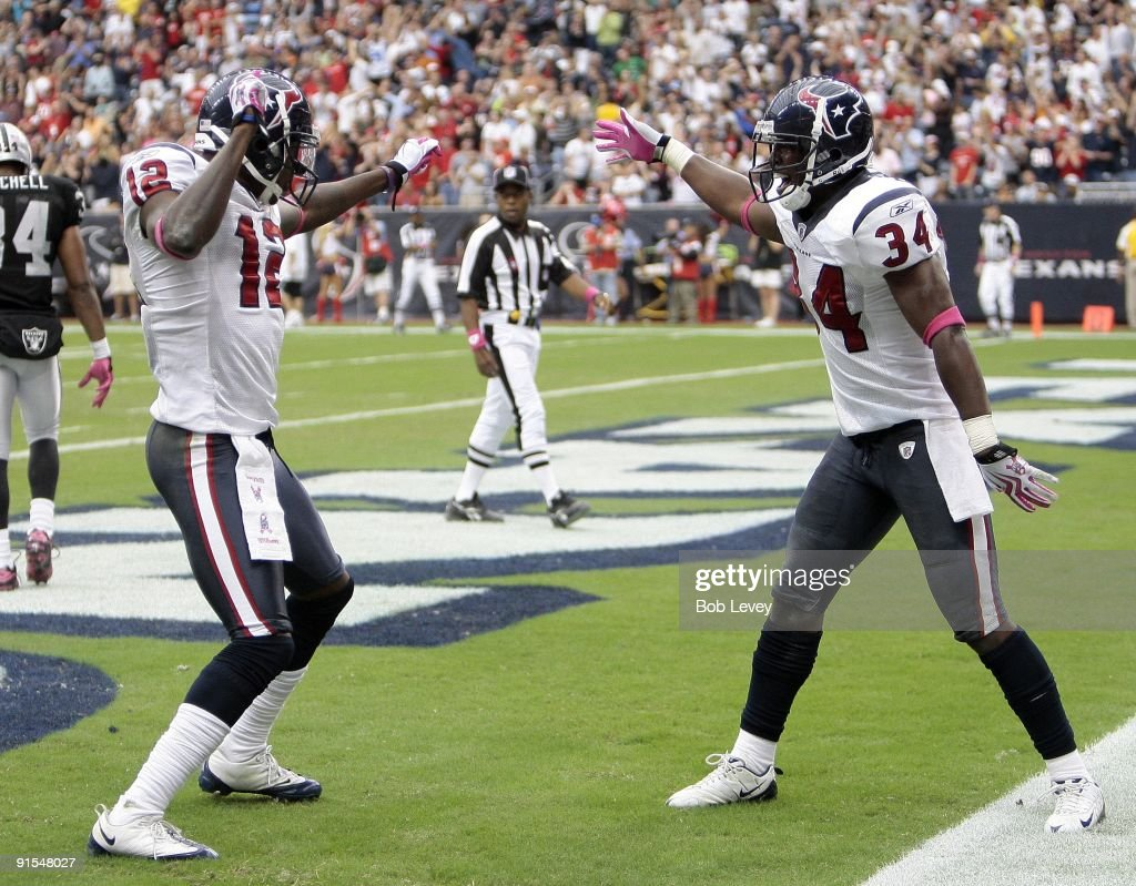 Houston Texan <a gi-track='captionPersonalityLinkClicked' href=/galleries/search?phrase=Jacoby+Jones&family=editorial&specificpeople=4167942 ng-click='$event.stopPropagation()'>Jacoby Jones</a> #12 of the Houston Texans receives congratulations from teammate Dominique Barber #34 after his 95 yard kick return at Reliant Stadium on October 4, 2009 in Houston, Texas.