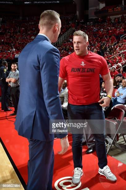Houston Texan JJ Watt and American Soccer player Kealia Ohai talk to Sam Dekker of the Houston Rockets before the Western Conference Quarterfinals...