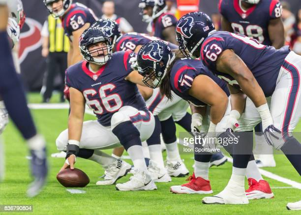 Houston Texans center Nick Martin talks to the offensive line during the NFL preseason game between the New England Patriots and Houston Texans on...
