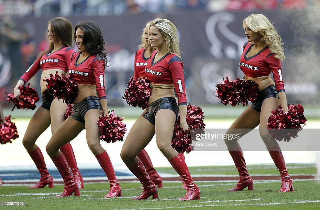 Houston Texans cheerleaders perform during a football game between the Jacksonville Jaguars and the Houston Texans at Reliant Stadium on October 30, 2011 in Houston, Texas.