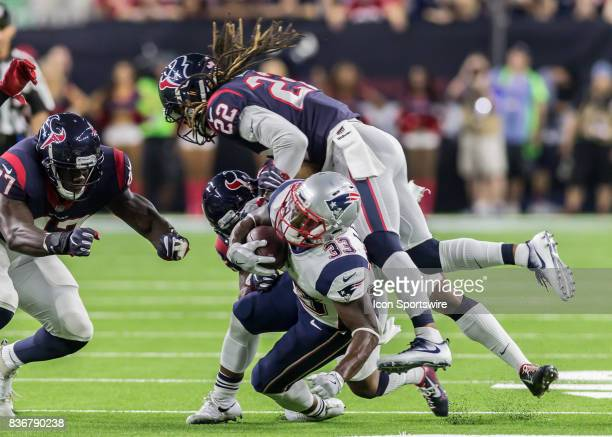Houston Texans cornerback Denzel Rice tackles New England Patriots running back Dion Lewis during the NFL preseason game between the New England...