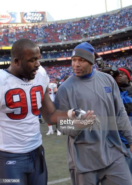 Houston Texans DE Mario Williams talking with New York Giants defensive end Michael Strahan the end of the game Pro Bowl defensive end Michael...