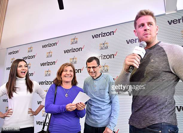 "Houston Texans defensive end JJ Watt and actress and recording artist Victoria Justice participate in the ""Game Winner"" experience at Verizon Access..."