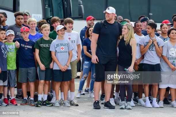 Houston Texans defensive end JJ Watt and his girlfriend Houston Dash star Kealia Ohai pose for a photo op before the press conference during the JJ...