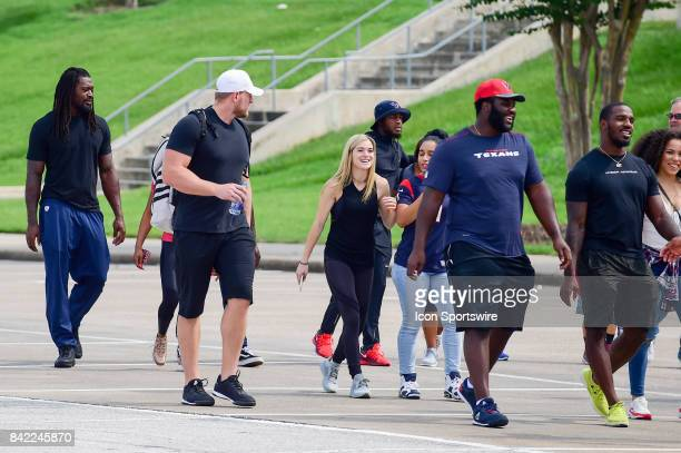 Houston Texans defensive end JJ Watt and his girlfriend Houston Dash star Kealia Ohai make their way to the press conference during the JJ Watt and...
