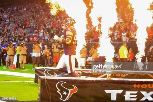 Houston Texans defensive end JJ Watt enters the field before the NFL preseason game between the New England Patriots and the Houston Texans on August...