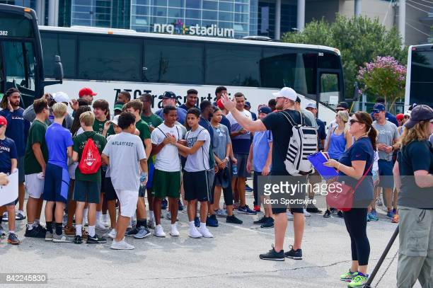 Houston Texans defensive end JJ Watt gathers his team for a photo op before the press conference during the JJ Watt and Houston Texans Hurricane...