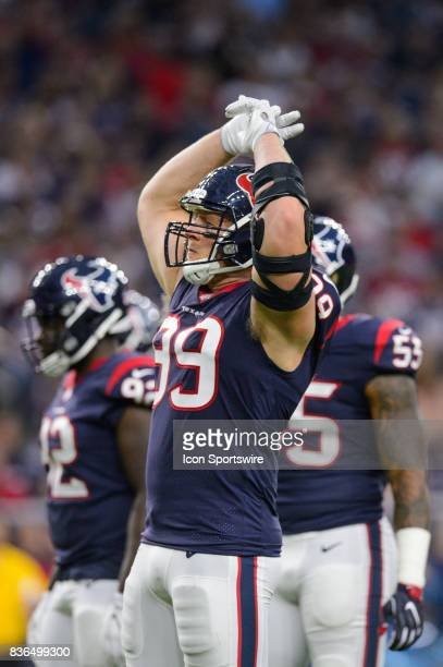 Houston Texans defensive end JJ Watt gets the crowd excited during the NFL preseason game between the New England Patriots and the Houston Texans on...
