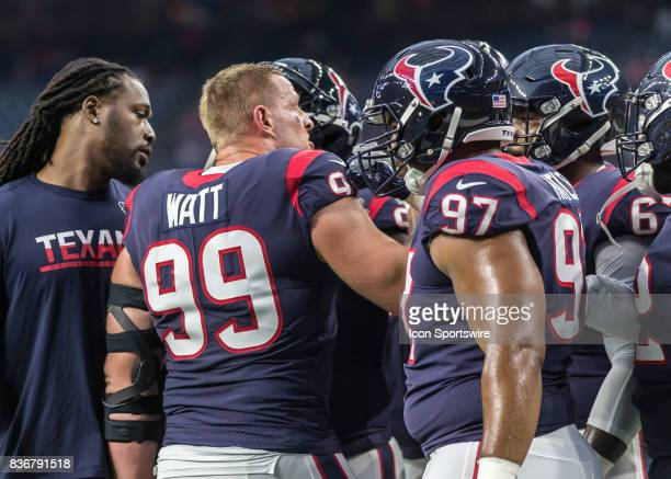 Houston Texans defensive end JJ Watt gives teammates a pep talk during the NFL preseason game between the New England Patriots and Houston Texans on...