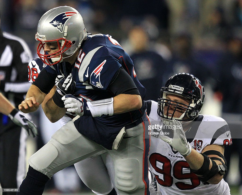 Houston Texans defensive end J.J. Watt (#99) pressures New England Patriots quarterback Tom Brady (#12) during the second quarter as the New England Patriots hosted the Houston Texans in an NFL AFC Divisional Playoff Game at Gillette Stadium, Jan. 13, 2013.