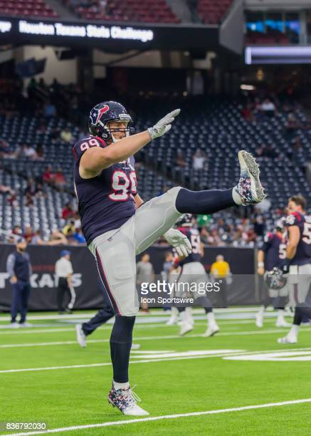 Houston Texans defensive end JJ Watt warms up during the NFL preseason game between the New England Patriots and Houston Texans on August 19 2017 at...