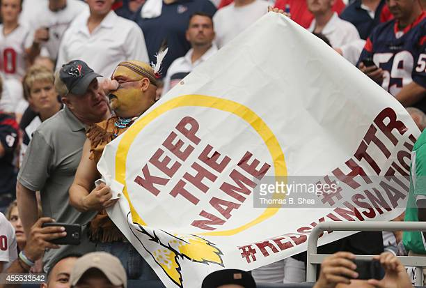 Houston Texans fan argues with a Washington Redskins fan on September 7 2014 at NRG Stadium in Houston Texas