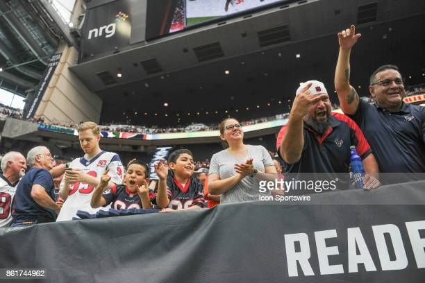 Houston Texans fans cheer for Houston Texans wide receiver DeAndre Hopkins' second half touchdown reception during the football game between the...