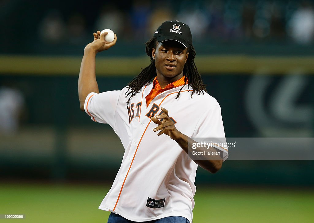 Houston Texans first round draft pick DeAndre Hopkins tosses the first pitch before the game between the Kansas City Royals and Houston Astros at Minute Maid Park on May 21, 2013 in Houston, Texas.