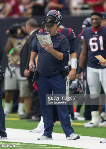 Houston Texans head coach Bill O'Brien examines the play sheet during the NFL game between the Tennessee Titans and Houston Texans on October 1 2017...