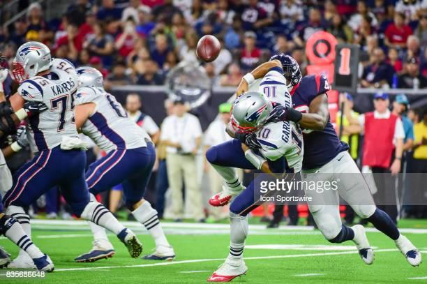 Houston Texans linebacker Tony Washington Jr hits New England Patriots quarterback Jimmy Garoppolo forcing a fumble during the NFL preseason game...