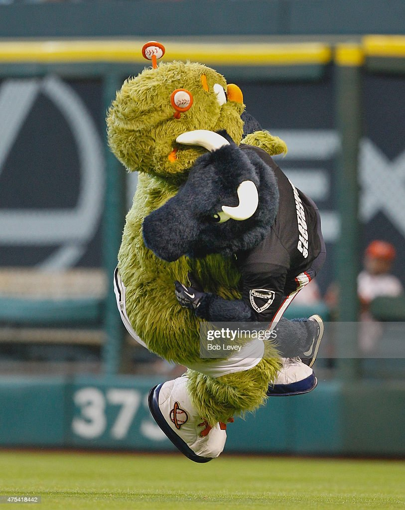 Houston Texans mascot Toro crossbody blocks Houston Astros mascot Orbit after he was running through the outfield in his underwear celebrating his...