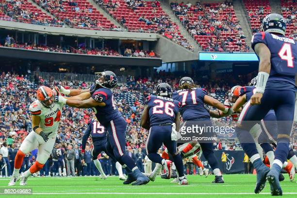 Houston Texans offensive tackle Kendall Lamm takes a shot to the face by Cleveland Browns defensive end Carl Nassib as Houston Texans running back...