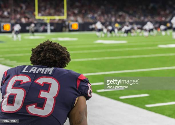 Houston Texans offensive tackle Kendall Lamm watches the game from the sideline during the NFL preseason game between the New England Patriots and...