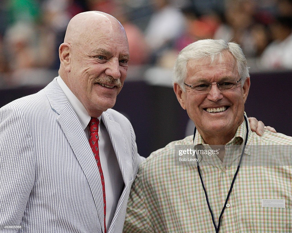 Houston Texans owner Bob McNair, left, poses with former NFL football coach Dick Vermeil during pre-game activities before playing the Atlanta Falcons at Reliant Stadium on August 16, 2014 in Houston, Texas.
