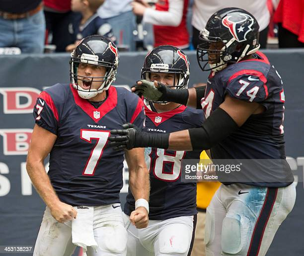 Houston Texans player Case Keenum celebrates his 5yard touchdown run with teammate Wade Smith during third quarter action against the New England...