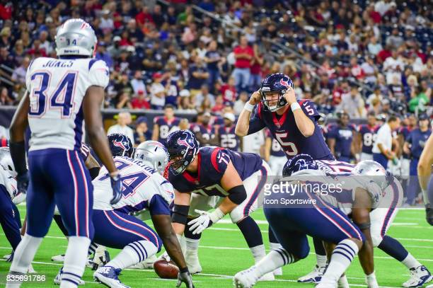 Houston Texans quarterback Brandon Weeden calls an audible at the line of scrimmage during the NFL preseason game between the New England Patriots...