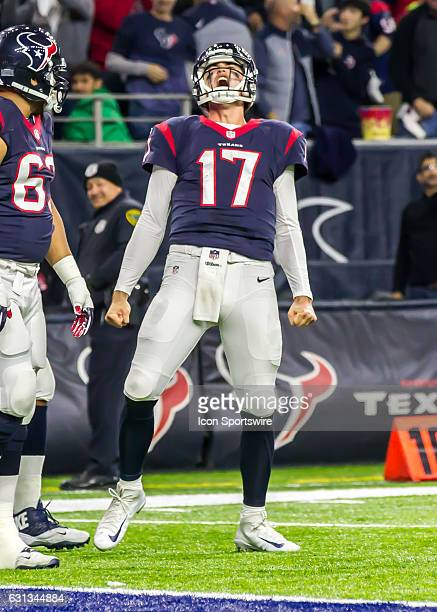 Houston Texans quarterback Brock Osweiler celebrates after making a touchdown during the NFL AFC Wild Card game between the Oakland Raiders and...