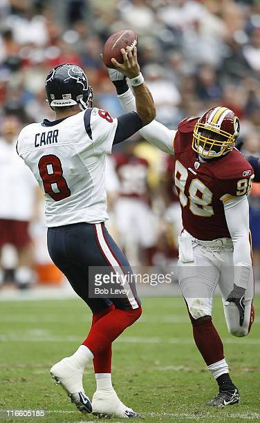 Houston Texans quarterback David Carr has his pass attempt knocked down by Washington Redskins linebacker Lemar Marshall versus Washington at Reliant...